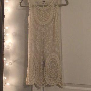 Beautiful lace mini dress with detailing!